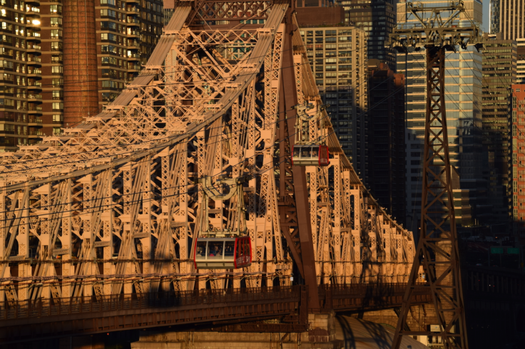 Dueling Trams ease across the East River